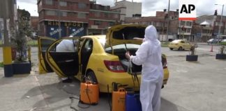 Taxi drivers become a disinfection squad in Colombia