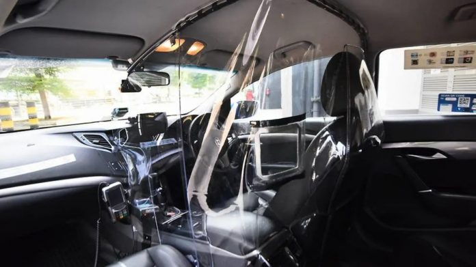 Taxis in Singapore will be outfitted with plastic isolation shields to protect drivers against COVID-19